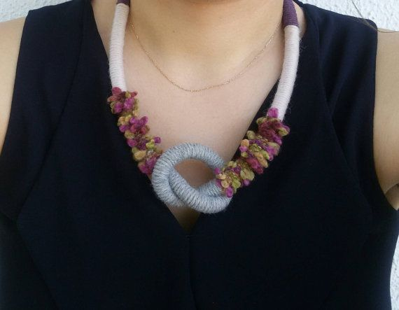 Check out this item in my Etsy shop https://www.etsy.com/listing/128596322/yarn-necklace-knot-necklace-wrapped-yarn