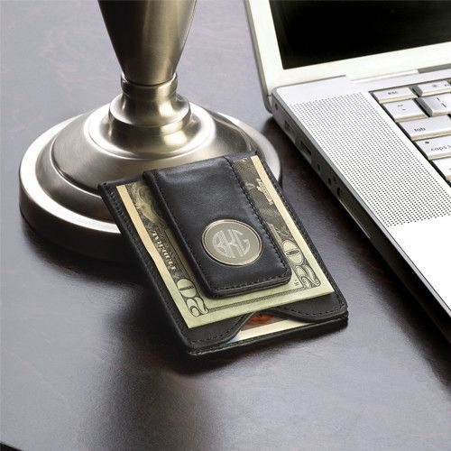 Our Personalized Leather Wallet & Money Clip makes the perfect accessory for your wedding attendants. Featuring a much slimmer profile than the traditional wallet, this gift for groomsmen can be tucked into the tuxedo pant pocket without making a lump.Crafted from genuine leather with a black finish, this wallet and money clip combo features a clasp to hold bills and