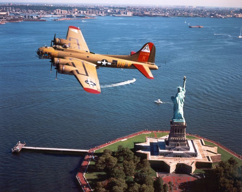 B 17 Nine O Nine Flying Over Miss Liberty In New York Harbor B 17 Statue Of Liberty Wwii Aircraft Aircraft Military Aircraft