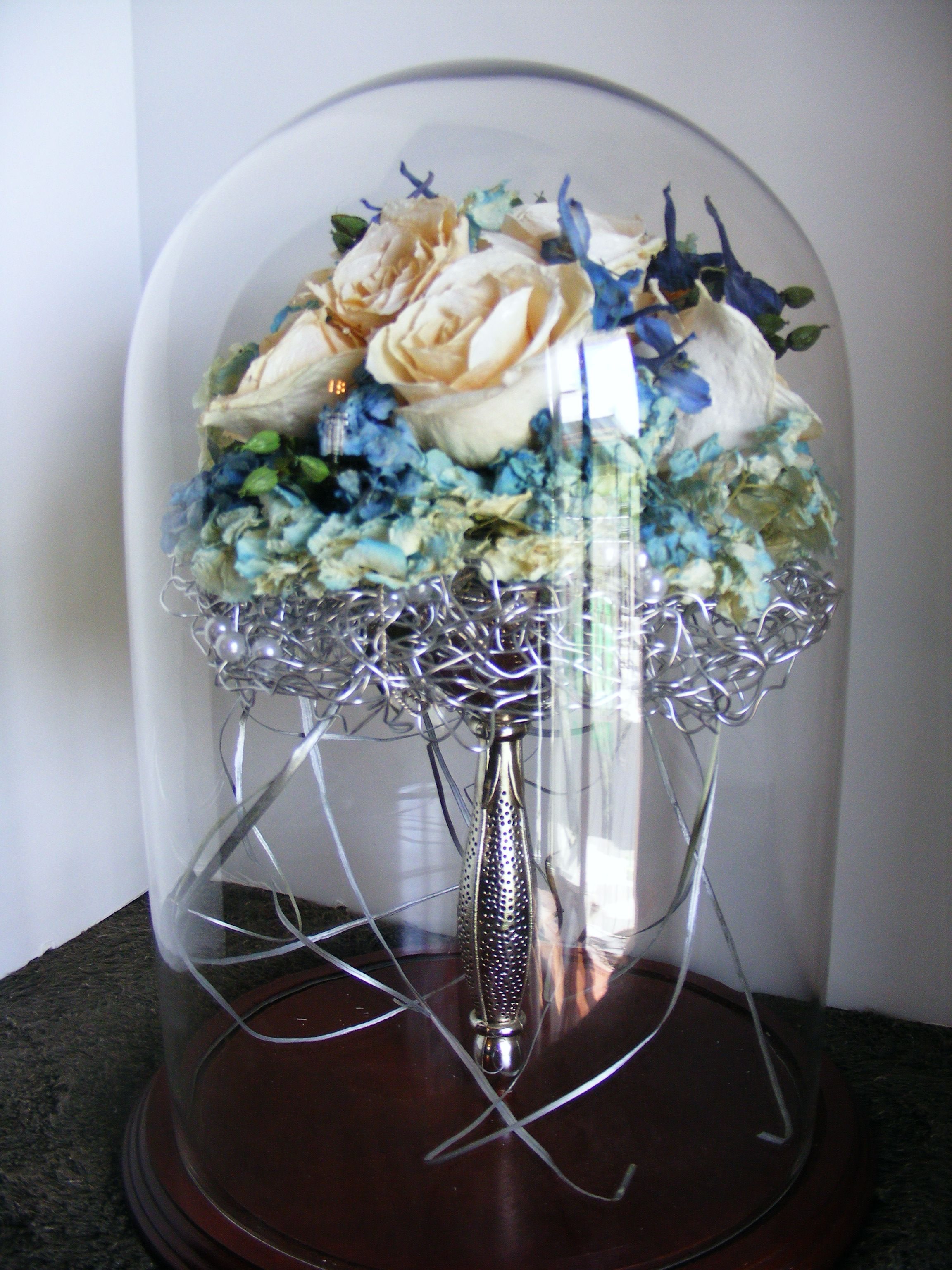 Flowers Made Into Glass Domes Displays Wedding Dress