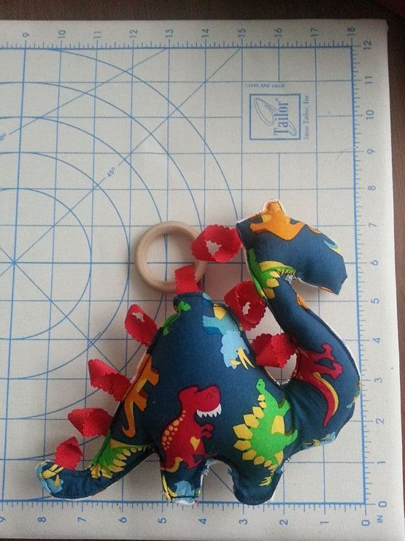 Stuffed Dinosaur Teething Toy with natural wooden ring (medium size, $15)