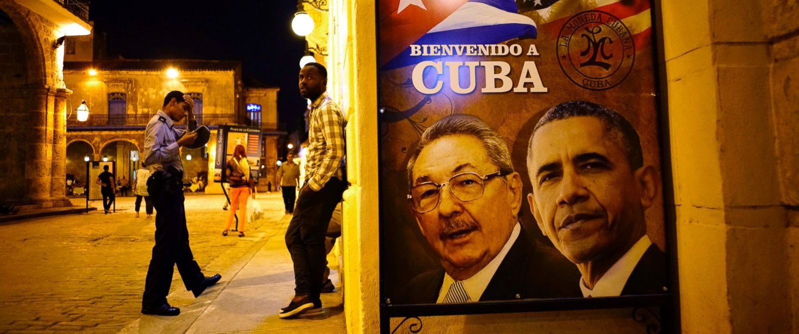 """PHOTO: A poster features portraits of Cubas President Raul Castro, left, and President Barack Obama and reads in Spanish """"Welcome to Cuba"""" outside a restaurant in Havana, Cuba, March 17, 2016."""