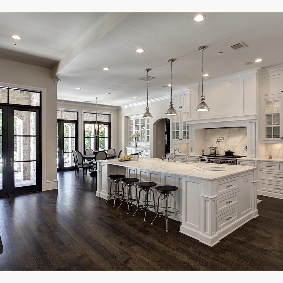 Love the contrast of white and dark wood floors by for Hardwood floors kitchen