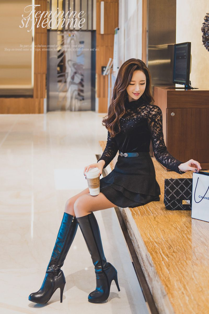Original Stylish Young Asian Woman In Black Blazer And Boots Stock Photo | Getty Images