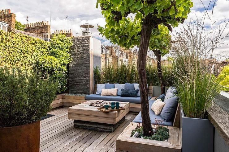 Stunning Rooftop Deck Features Wooden Built In Benches Fixed Adjacent To Each Other On Either Side Of Roof Garden Design Rooftop Terrace Design Rooftop Design