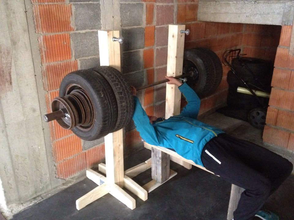 Wooden rack homemade barbell olympic weights wheel for Homemade log bench