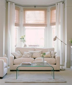 to accentuate the rooms height and make it feel even more spacious hang long white bay window - Bay Window Ideas Living Room