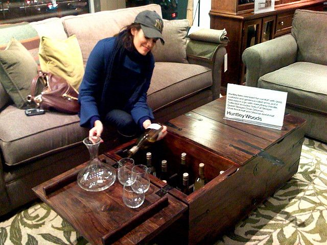 maybe coolest coffee table ever opens up to reveal a secret liquor