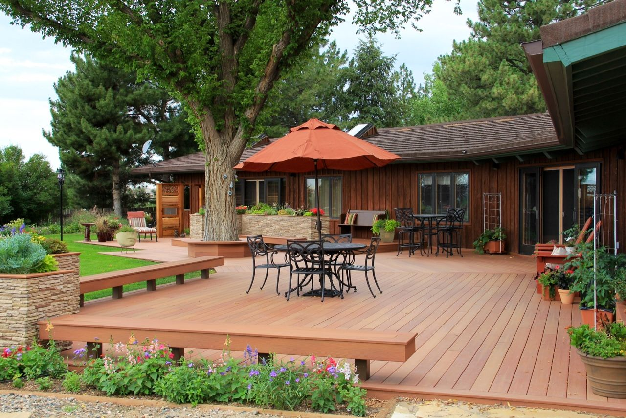 This eco-friendly deck is made from Fiberon composite decking. The step-up design helps define different areas of the space. The home owner also used the composite deck boards for bench seating. The product used is Fiberon's ProTect Advantage, in the 'Western Cedar' color.