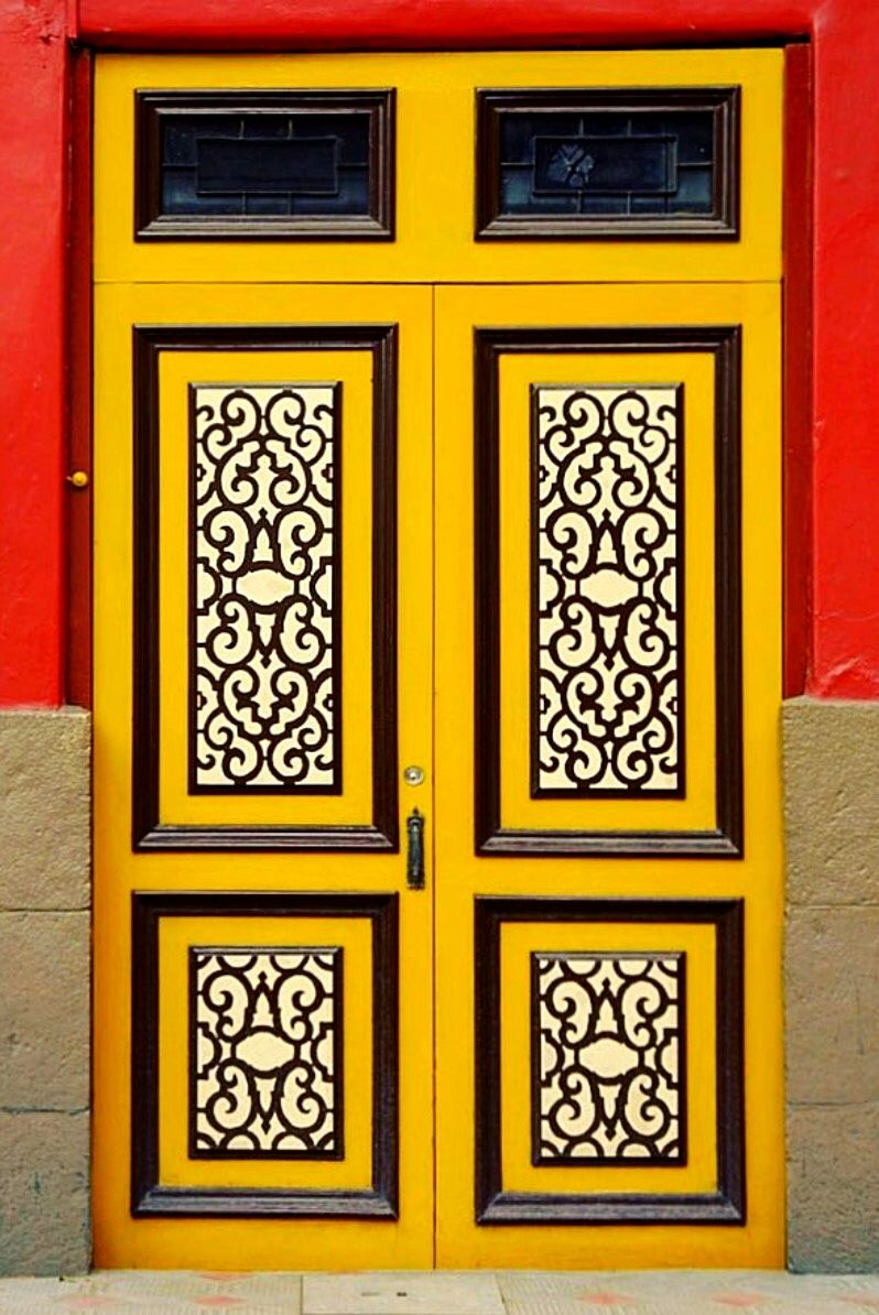 Lovely yellow doors with black and white panels cuenca azuay
