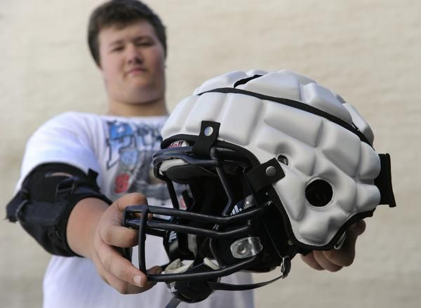 Guardian Cap used by football teams to protect against head injury - Columbine High School Football