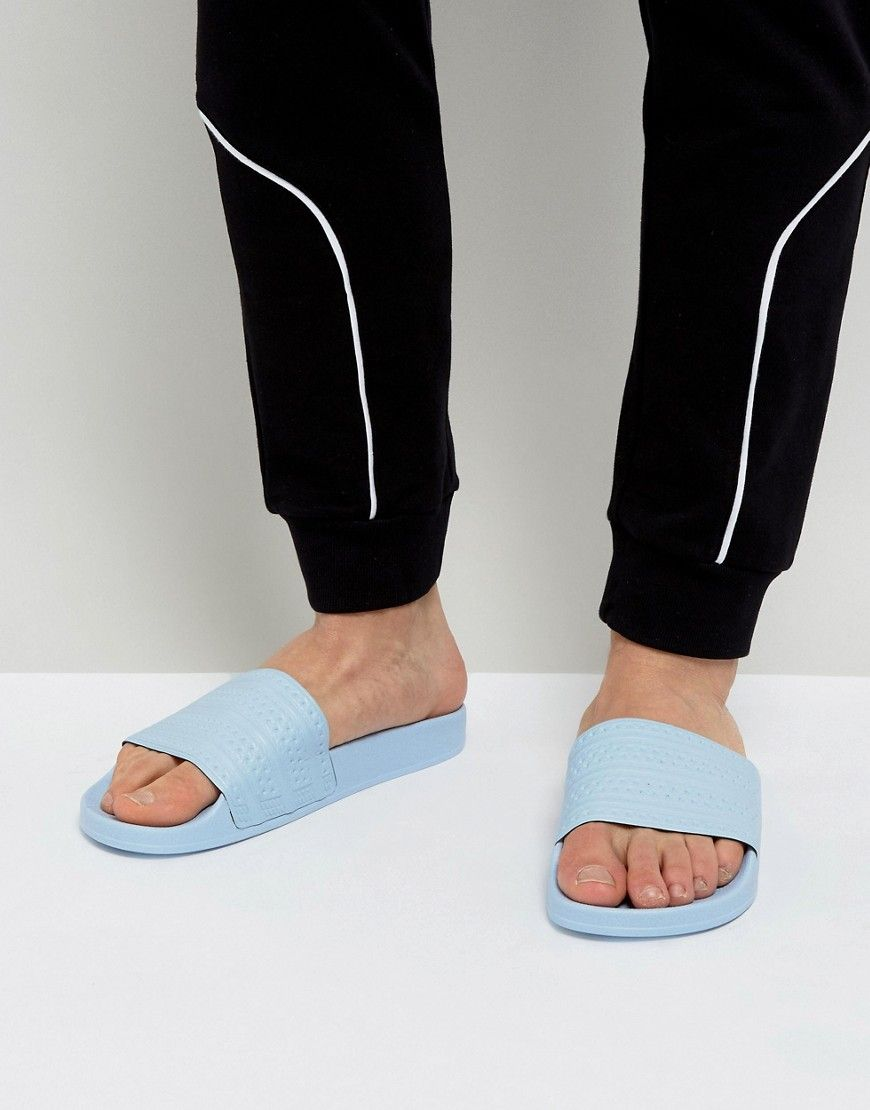 promo code f1f67 977e7 Get this Adidas Originals s flip flops now! Click for more details.  Worldwide shipping. Adidas Originals Adilette Slides In Blue BA7539 - Blue   Sandals by ...