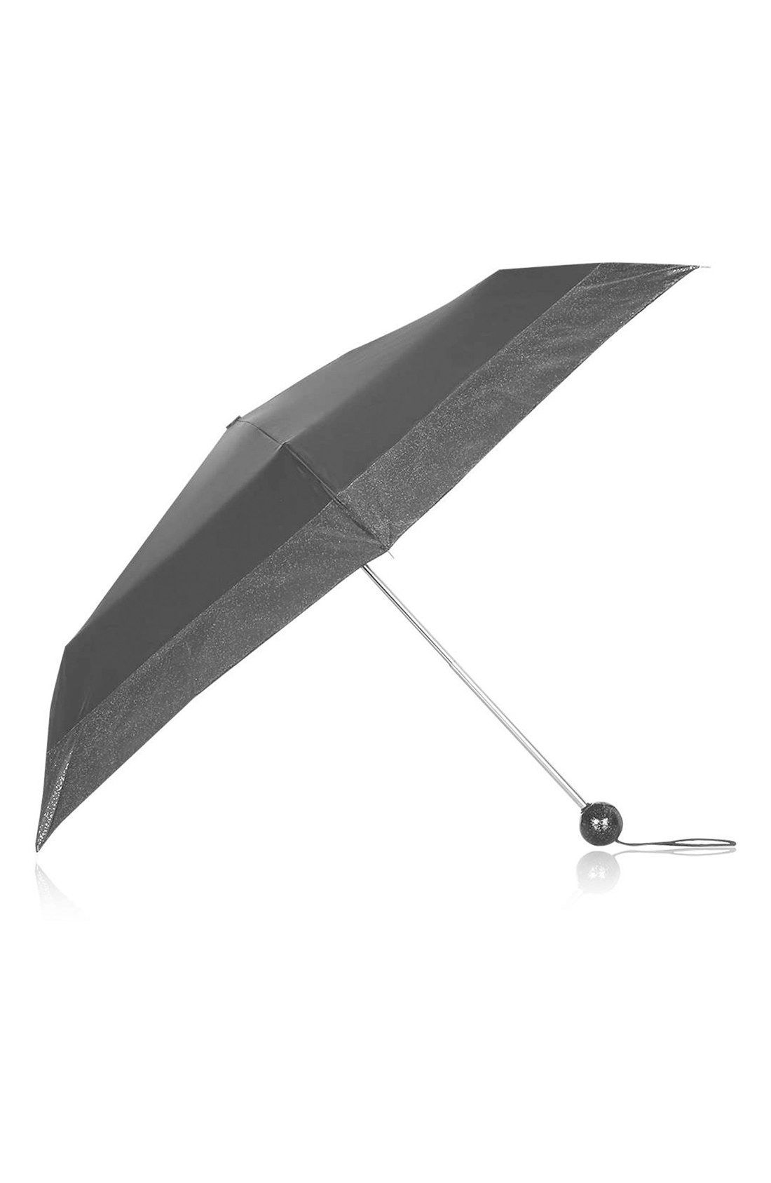 Hide away from those spring showers with this chic glittery Topshop umbrella.