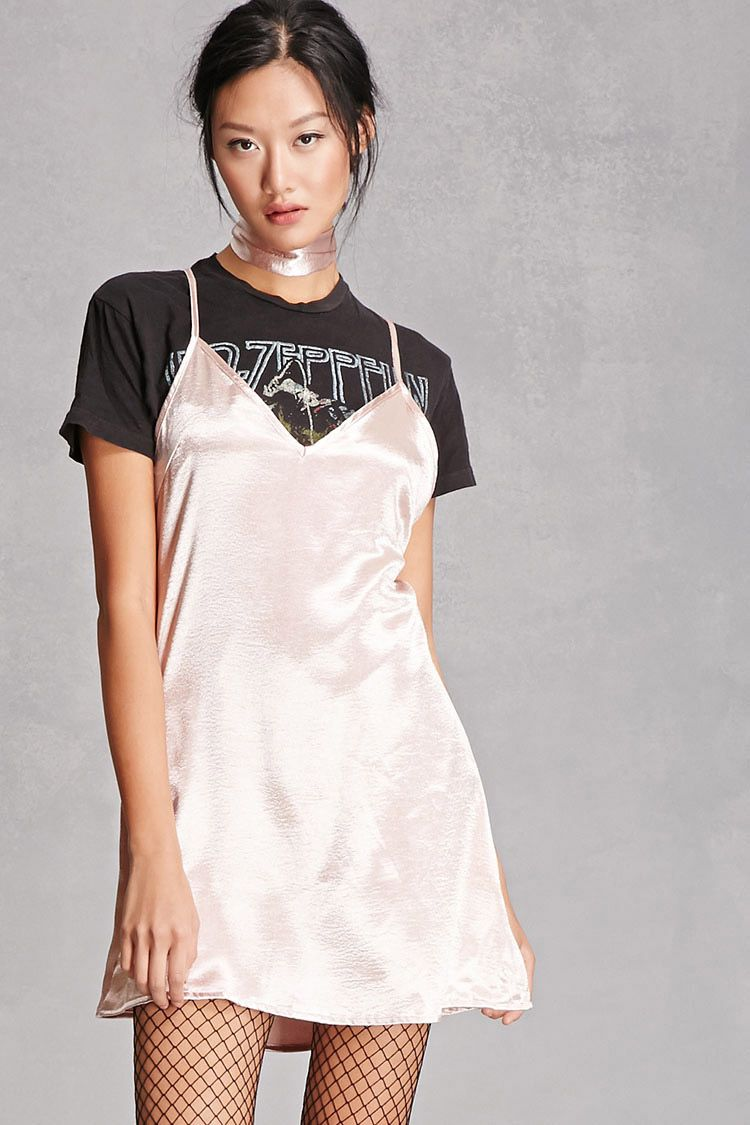 060161e20cf6 A woven metallic satin slip dress by Reverse™ featuring a removable choker  scarf, adjustable cami straps that crisscross at the back, a concealed back  ...