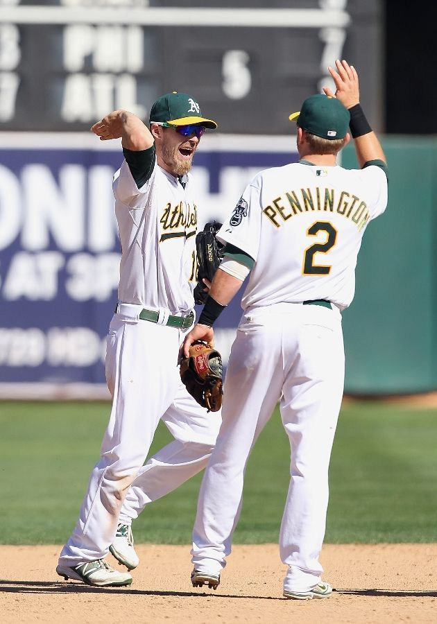 Josh Reddick #16 of the Oakland Athletics and Cliff Pennington #2 of the Oakland Athletics celebrate as the Oakland Athletics beat the Boston Red Sox 6-2 and sweep the series at O.co Coliseum on September 2, 2012