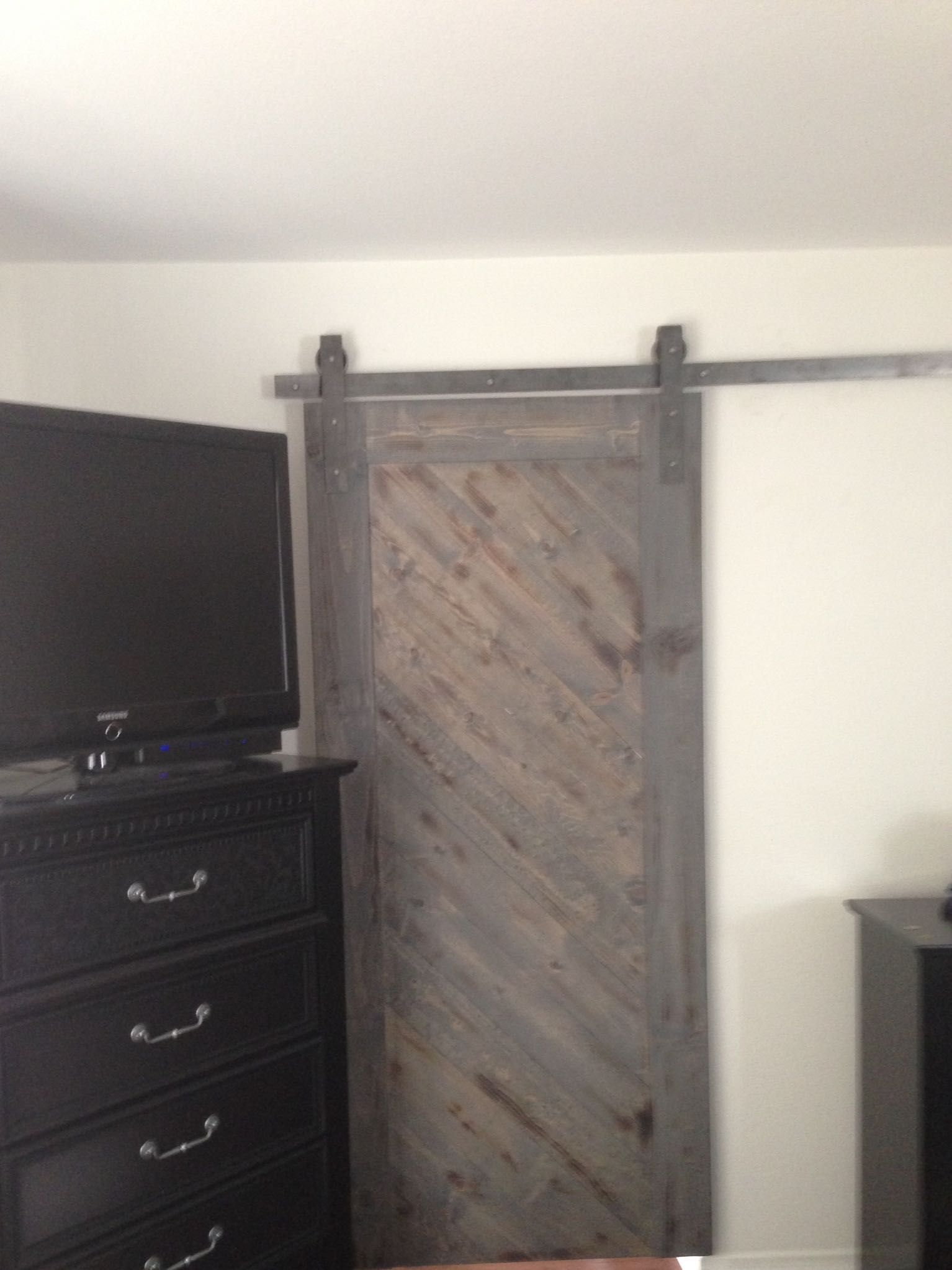 Gray Barn Door With A Diagonal Placed Reclaimed Wood Look