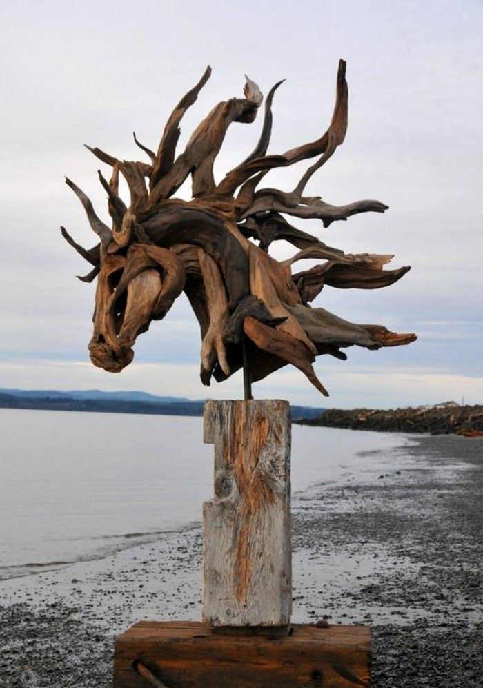 creation bois flotte figure sur la plage belle