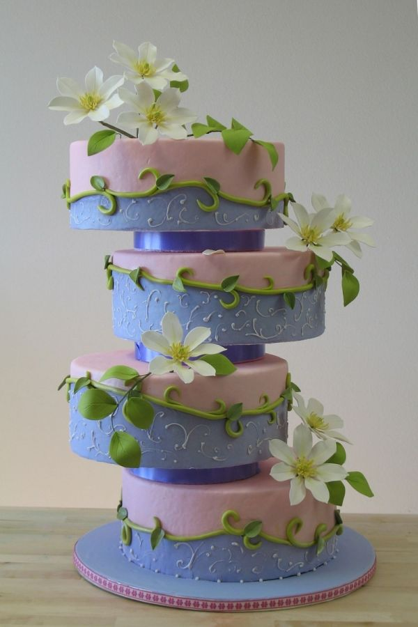 An offset tier cake with all the tiers the same size.  Blue and pink with vines