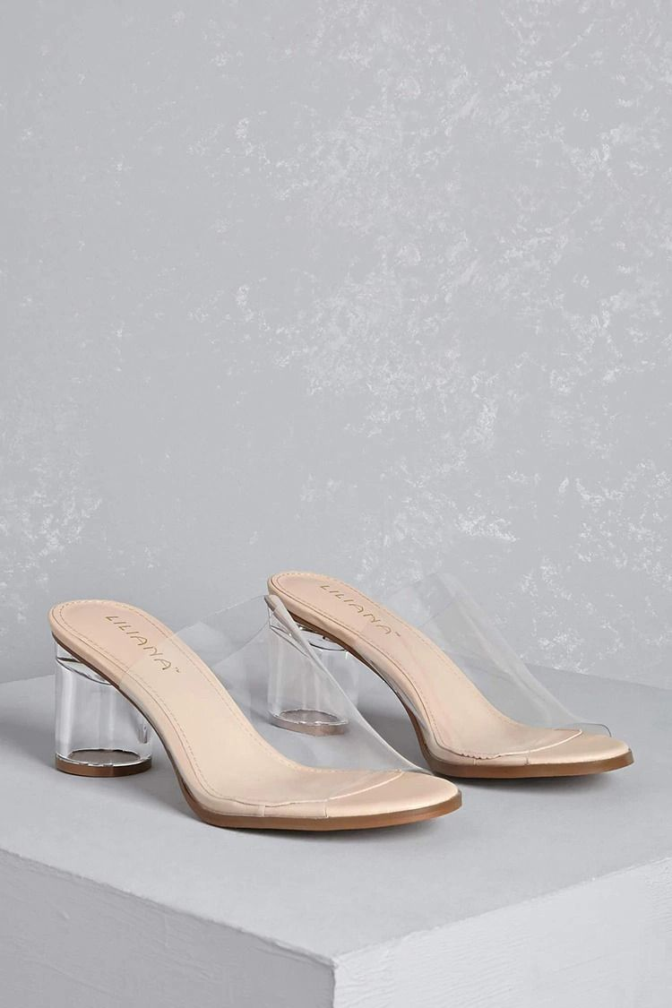 ef16d470fc6 A pair of clear vinyl mule slides featuring a lucite block heel and  open-toe design. p - This is an independent brand and not a Forever 21  branded item.  p