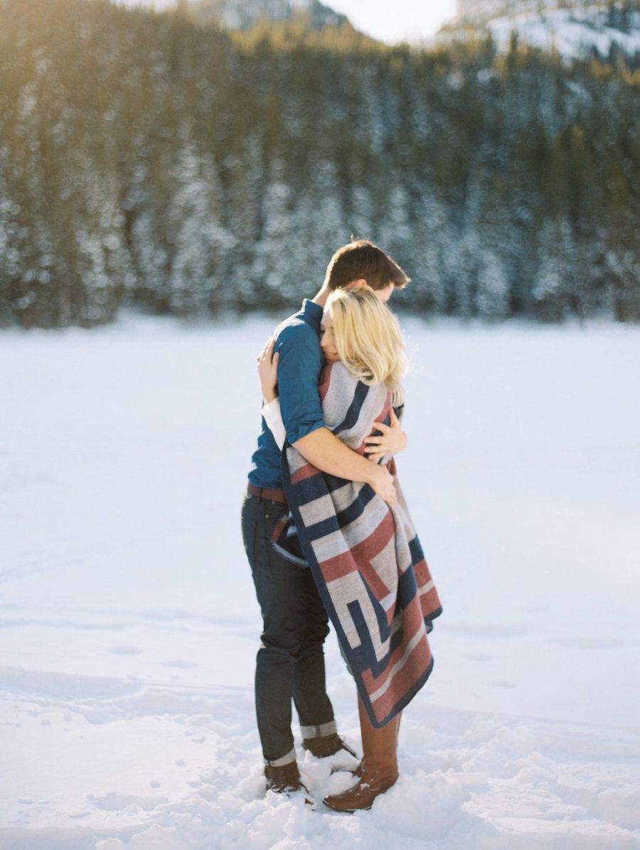 Photography : Winsome and Wright Read More on SMP: http://www.stylemepretty.com/2016/01/26/snowy-rocky-mountain-national-park-engagement/