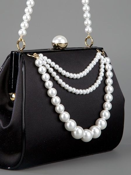 569ad4b0420 OK this is the last handbag of the night. This is so very classy. Just a  few pearls on a very simple black handbag. Moschino black silk and pearl  handbag