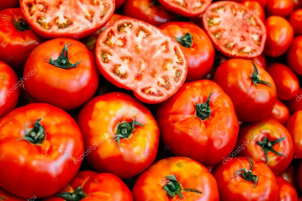 Fresh ripe red tomatoes forming background Stock Photo