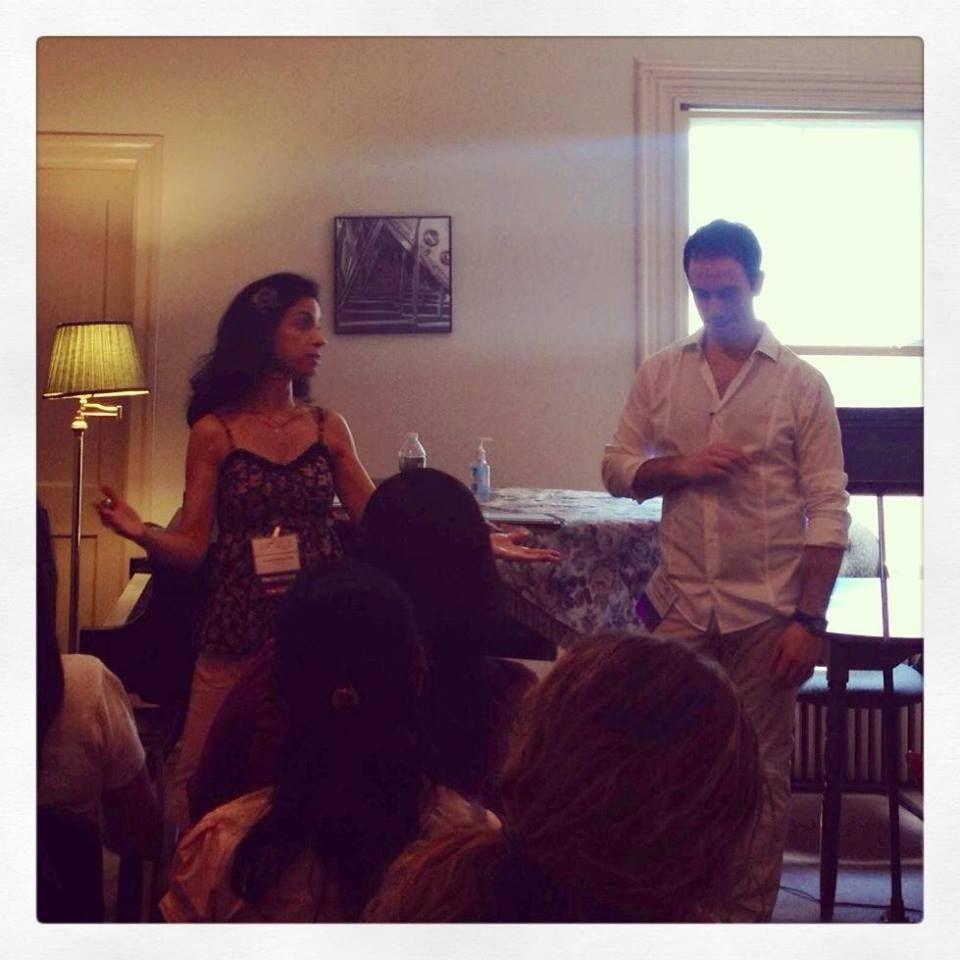 Gisele Oliveira and Gaetano Fava giving a workshop at #SYMP2013.