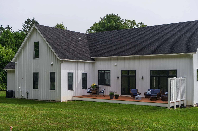 Modern farmhouse style nestled in an idyllic woodsy New