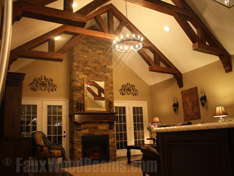 Great room with wood beams wooden trusses formed with for How to build a cathedral ceiling