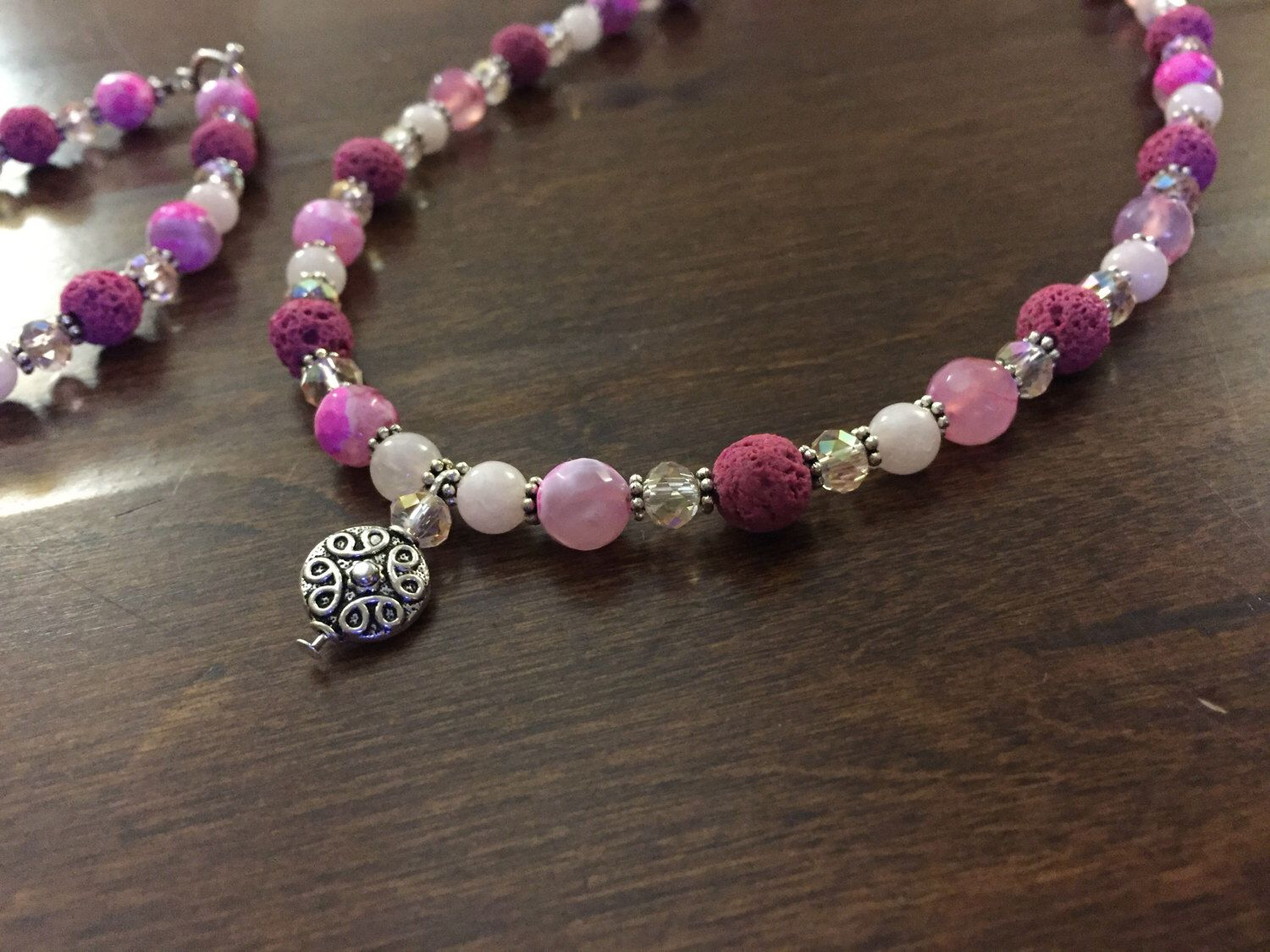 A personal favorite from my Etsy shop https://www.etsy.com/listing/499705754/pink-agate-crystal-and-lava-necklace
