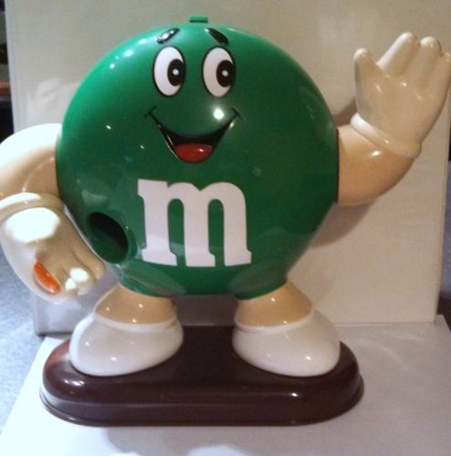M&M's Green Man Candy Dispenser. I had an orange one. I kind of miss that little guy.