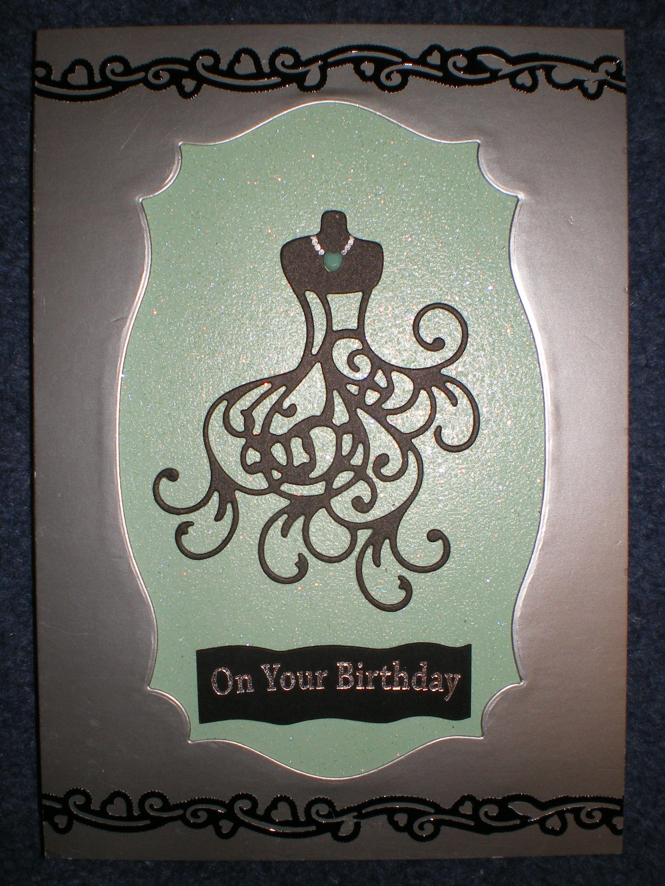 Glittery green framed dress card