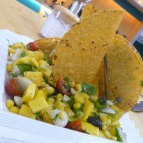 Corn and Raw Mango #Salad: Corn tossed in with spring onions, bell peppers, raw mango, pineapple, avocado, celery, cherry tomatoes and herbs to create a refreshing salad.