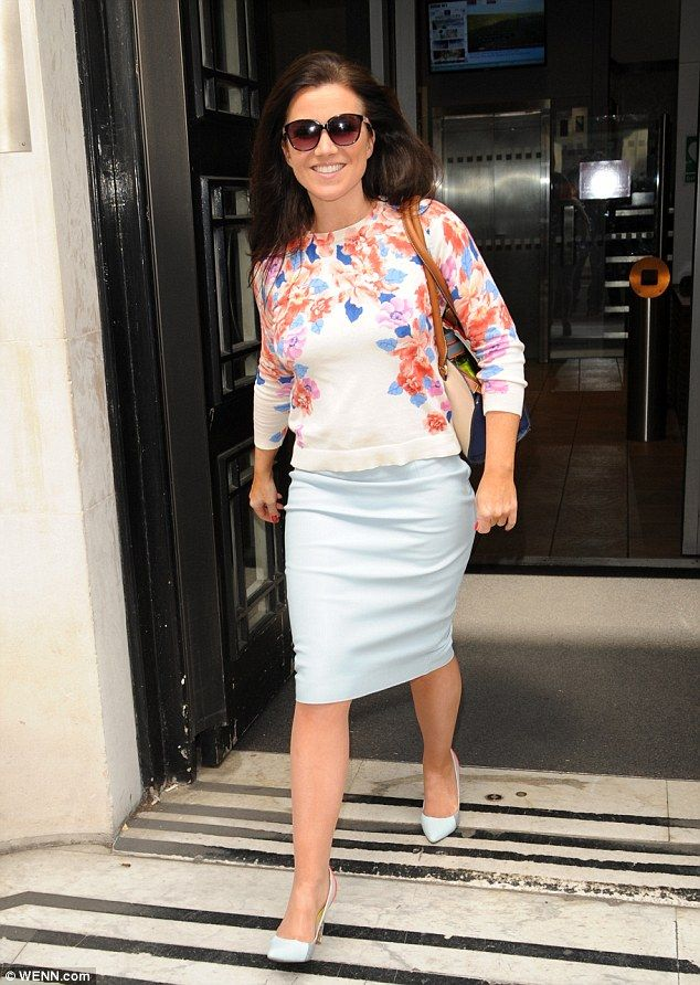 Mixing it up: Susanna Reid worked a summer look in a floral jumper and a light blue pencil...