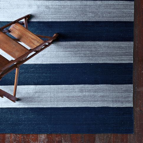 Bold stripe rug.  Lay it horizontally to fake a wider look and vertically to make a room look longer.