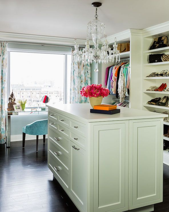 Beautiful Walk In Closet Features A Crystal Chandelier Over A Closet Island  Placed In Front