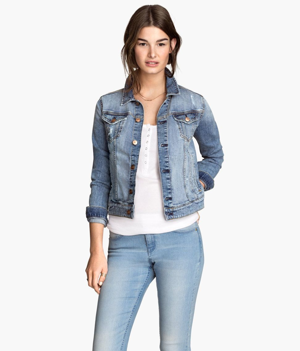 6434c8c21 Blue denim jacket with distressed details, chest pockets, and side ...