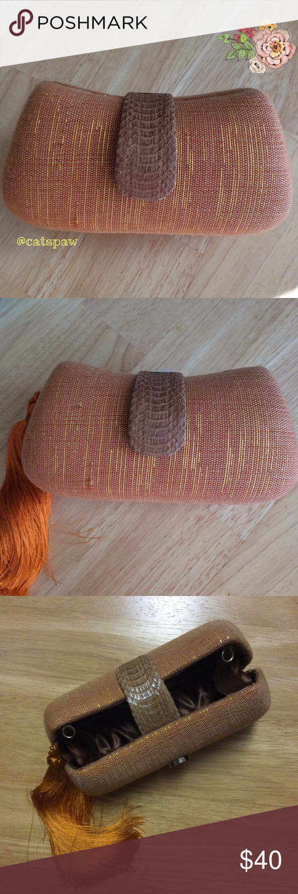 Woven clutch Rust-colored clutch, brand new. Handwoven, this beauty is secured with a leather strap. Accented with gold thread trimmings, the clutch features a magnetic closure and tassel. 6.5 inches in length, 3.5 inches in height and 2.75 inches thick. Bags Clutches & Wristlets