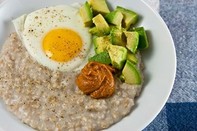Savory Oats    1/2c rolled oats  1 1/4c water [or half water + half milk]  s+p  Combine in a small pot and cook over medium heat, whisking occasionally, until desired consistency is met.  Toppings:    1 sunny side up egg  1/2 avocado  smoked paprika almond butter