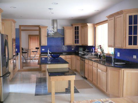 Cobalt Blue Kitchen Walls Except With Black Cabinets Sanded Down Peeks Of