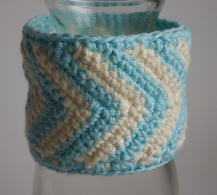 Ivory and aqua crochet chevron cuff displayed on a bottle free ...