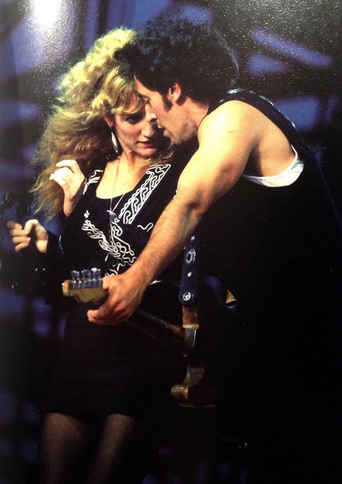 Bruce Springsteen & Patti Scialfa onstage in the 80's