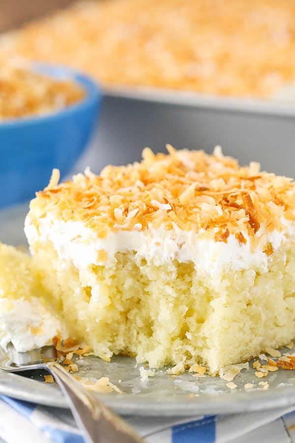 Coconut Cake Soaked With Sweetened Condensed Milk And Cream Of Coconut Then Topped With Cocon Coconut Cake Recipe Coconut Poke Cakes Moist Coconut Cake Recipe