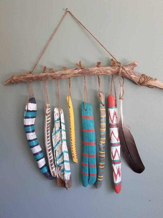 Choose whether to hang indoor or out, this unique piece will bring whimsy, fun, and the casual feeling of a beach house no matter where the location. Made from Nova Scotia driftwood collected from beaches along the South Shore there are seven pieces painted in bold colours of white,