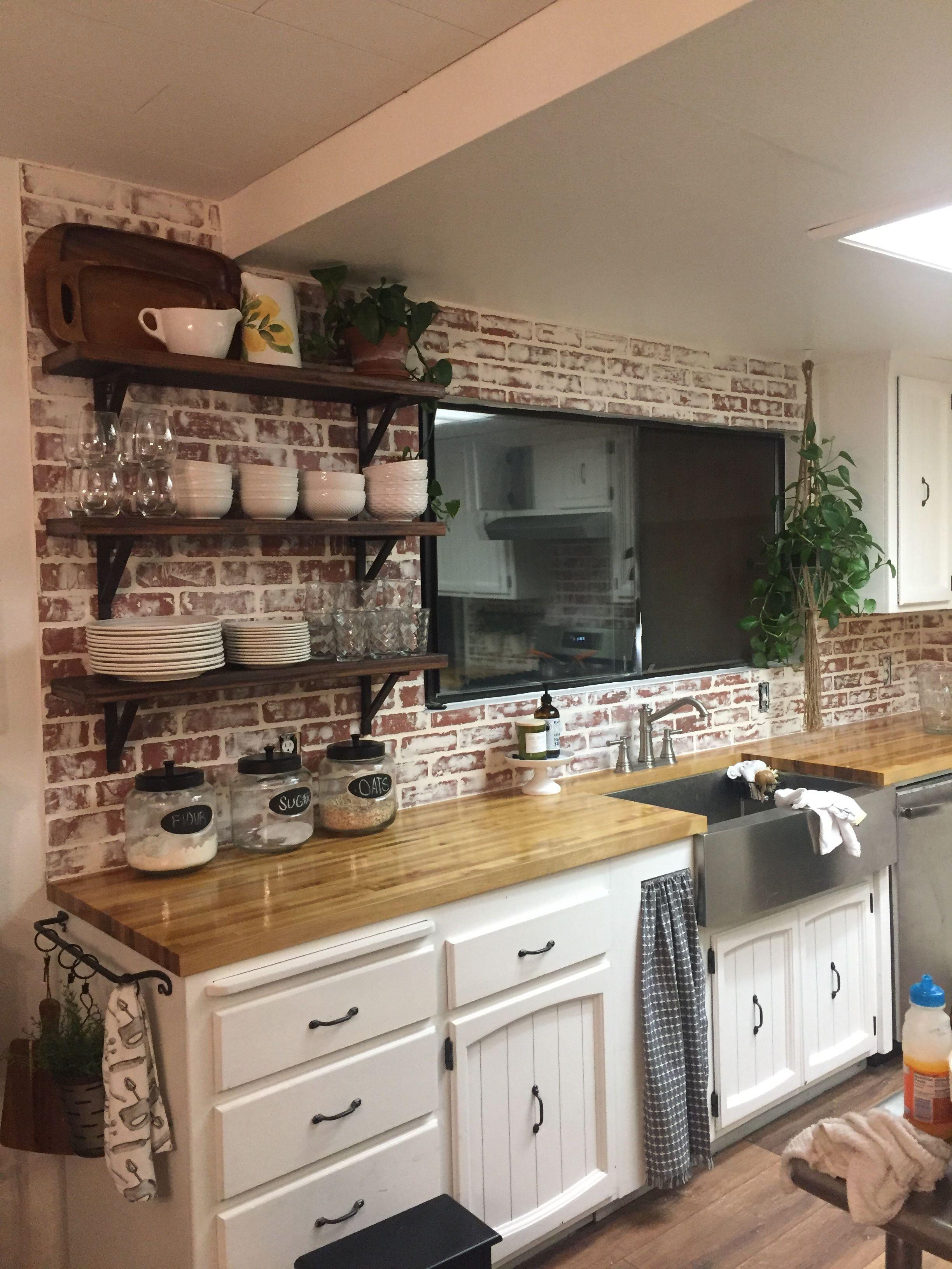 Farmhouse kitchen with faux brick backsplash 1000 in