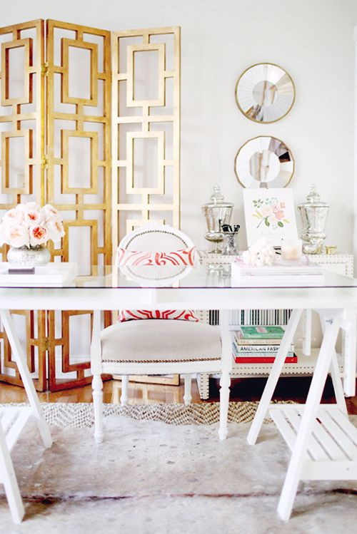 Adore the pops of gold that brighten up this office.