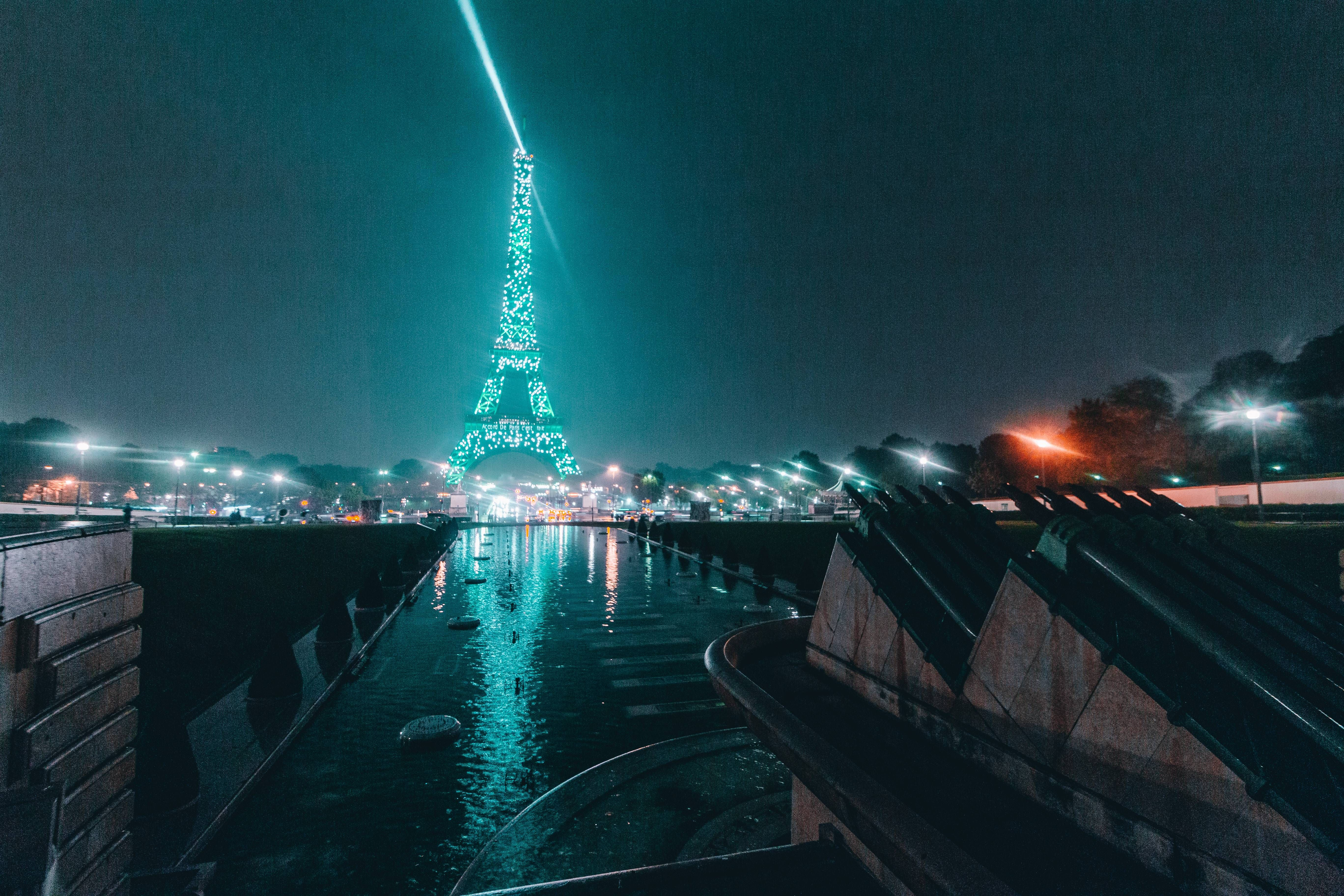 ITAP of the Eiffel Tower lit in green on a rainy day http://imgur.com/gallery/lFHJZ