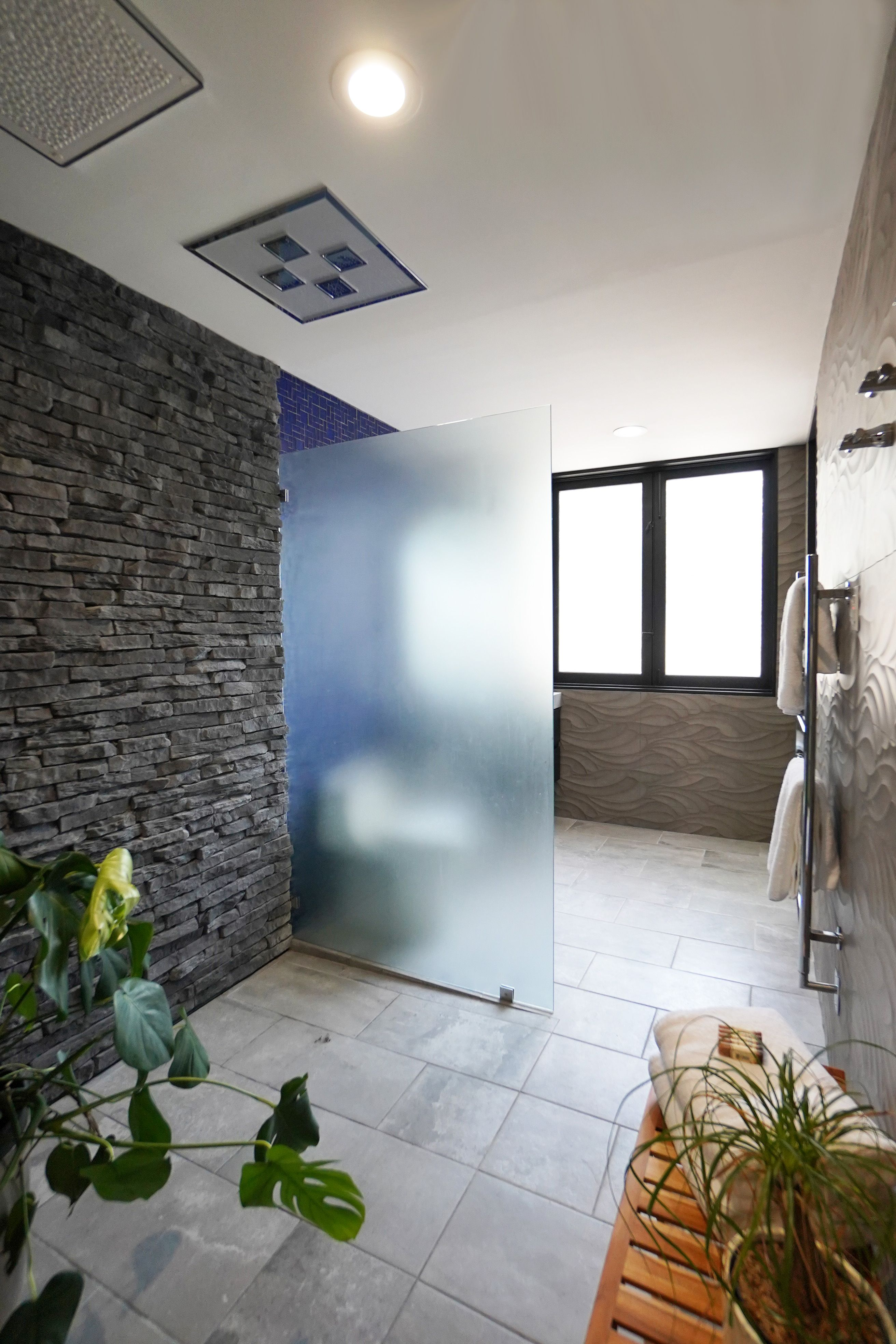 This pool house bathroom has large format architectural
