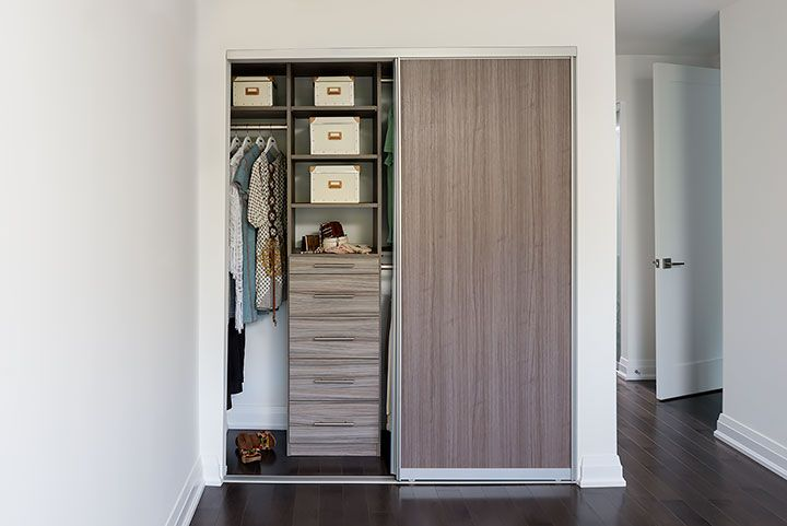 Condo Closet With Melamine Sliding Door Transitional Closet Closet Storage Systems Sliding Closet Doors Closet System