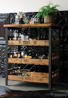 FleaingFrance.....industrial style. Great if you can find it-- or else stamp an available metal and wood shelving unit to make it more interesting.